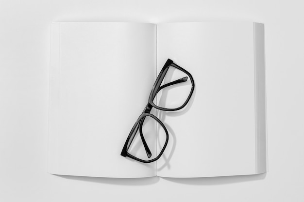 Copy space book and reading glasses