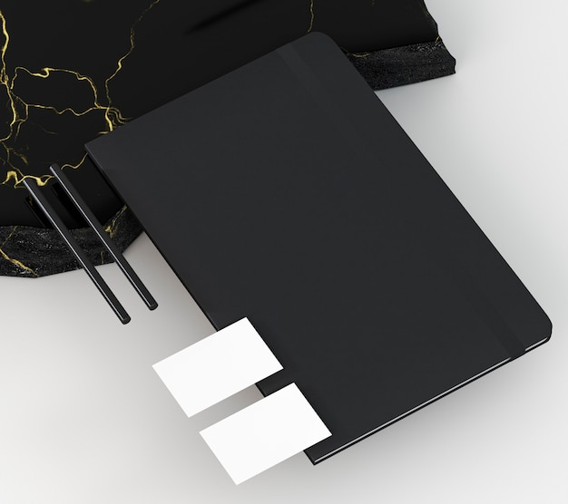 Copy space business card and black notebook