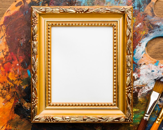 Copy space canvas in golden frame and paint