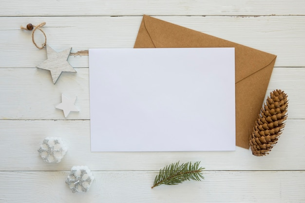 Copy space card with envelope and christmas decoration
