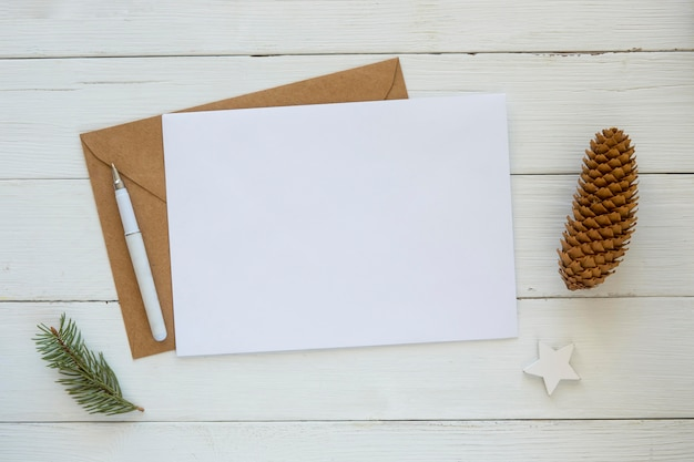 Copy space card with envelope and christmas pine needles and cone