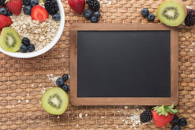 Copy space chalkboard and cereals with fruit