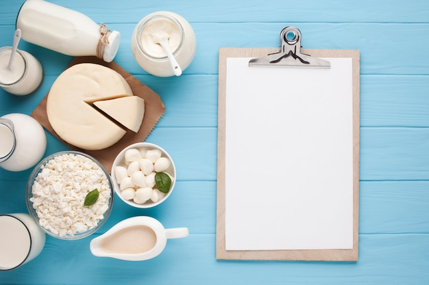 Copy space clipboard with dairy products