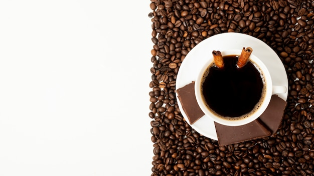 Copy space coffee cup with coffee beans arrangement