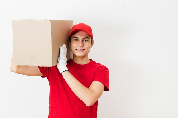 Copy-space delivery man carrying package