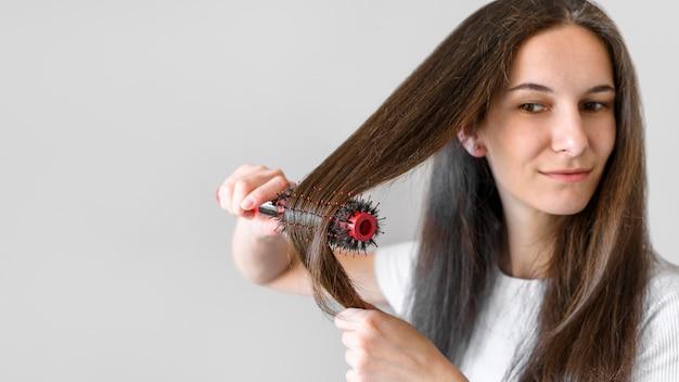 Copy-space female brushing hair