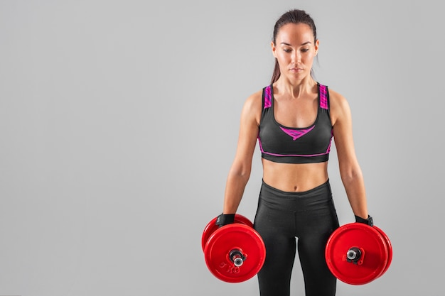 Copy-space female exercise with weights