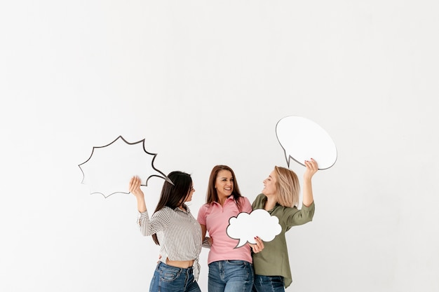Copy-space female friends holding chat bubble