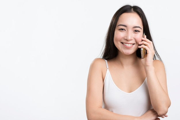 Copy-space female talking over phone