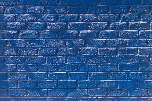 Copy space front view blue brick wall