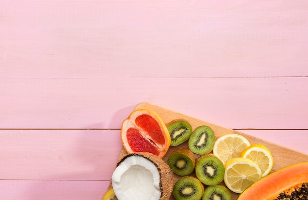 Copy space fruits on wooden board