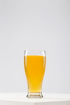 Copy-space glass with beer on table