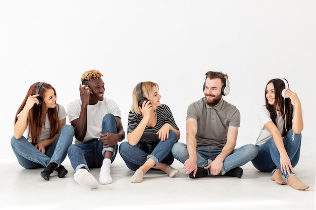 Copy-space group of friends sitting on floor