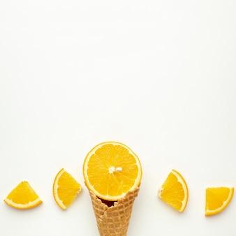 Copy-space ice cream cone with orange