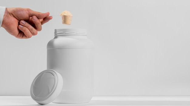 Copy-space jar with gym supplements