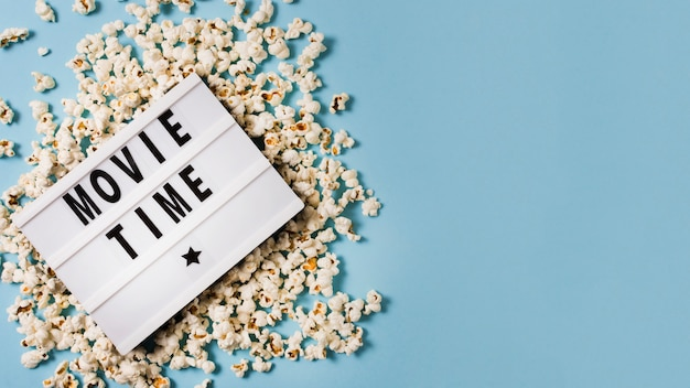Copy-space lightbox with popcorn on table