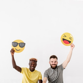 Copy-space male friends holding emoji
