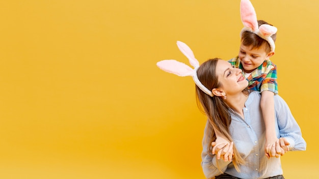 Copy-space mother and son with rabbit ears looking at each other