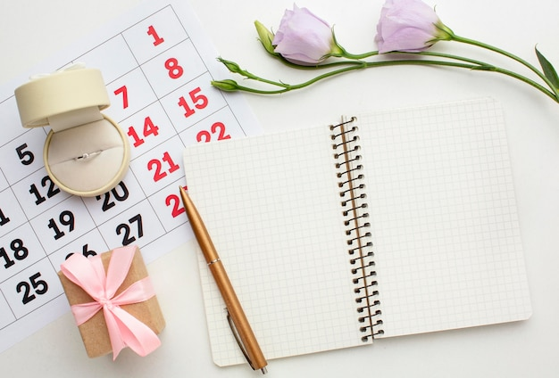 Copy space notebook and wedding calendar