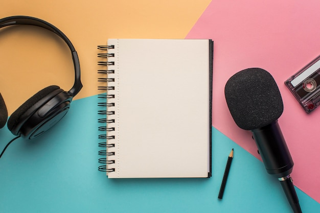 Copy space notepad with mic and headphones