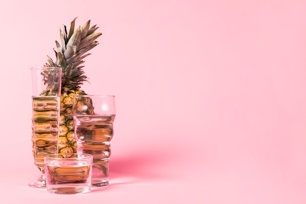 Copy space pink background pineapple