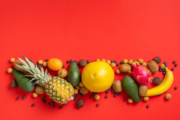A copy space, place for text desigh with fresh fruit on colorful background