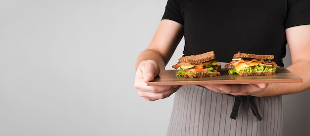 Copy-space sandwiches on wooden board