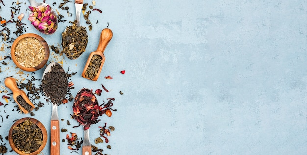 Copy-space scoop and bowls with herbal tea