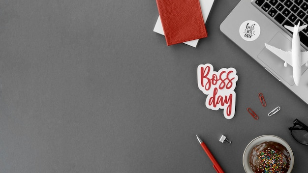 Copy-space sign with boss day on desk