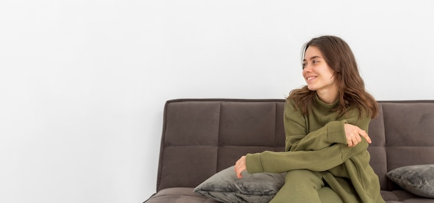 Copy-space smiley woman on couch
