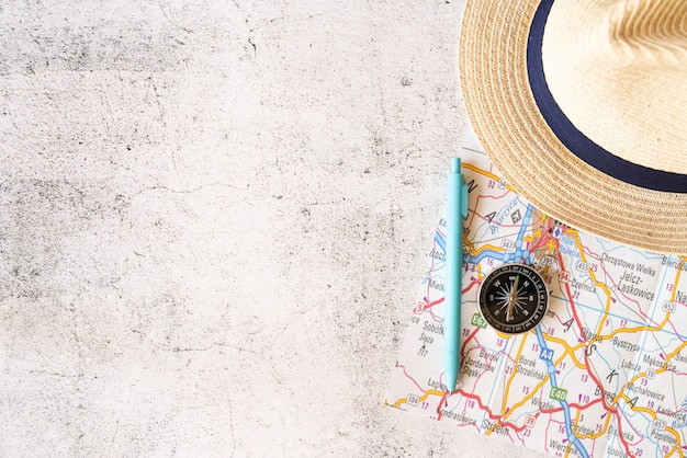 Copy space straw hat and map elements