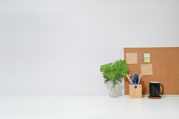 Copy space table with office supplies on workspace