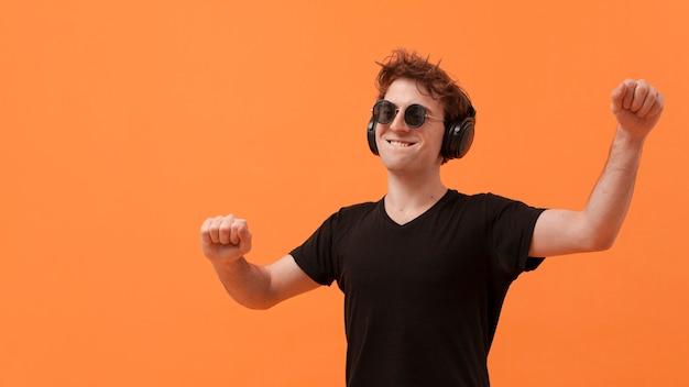 Copy-space teenage boy dancing