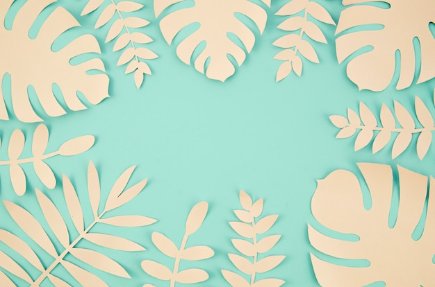 Copy space and tropical leaves in paper cut style