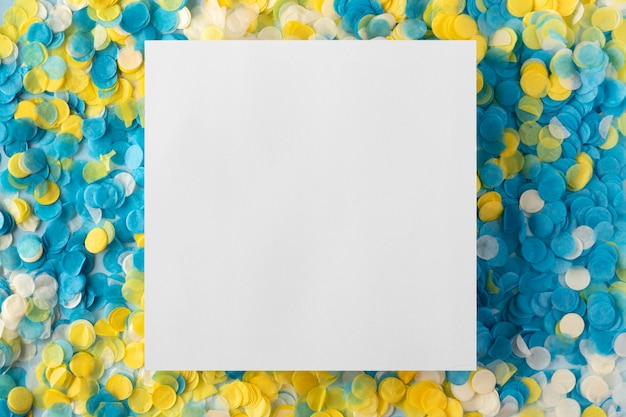 Copy space white card and confetti