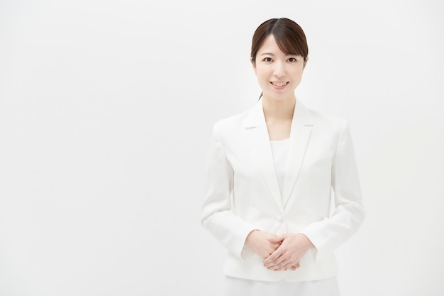 Copy space with a smiling woman in a white suit