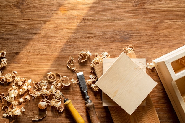 Copy space with tools and wood sawdust in workshop