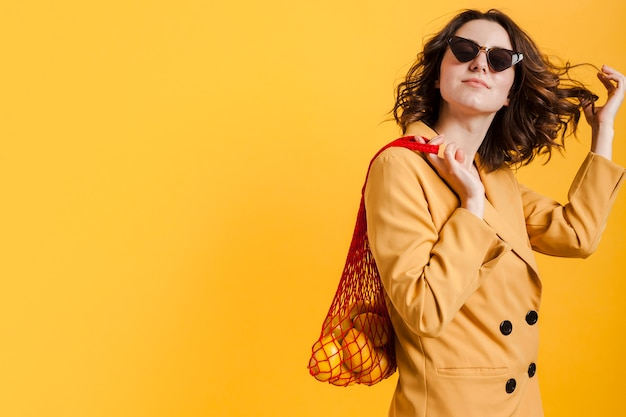 Copy-space woman carrying lemons