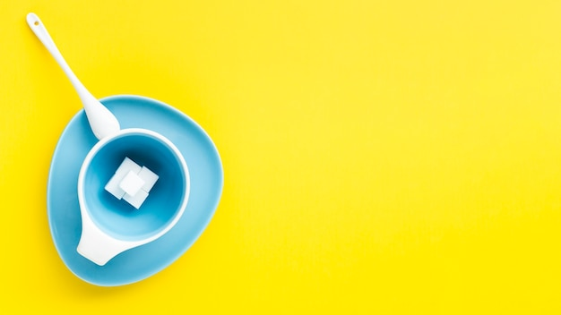 Copy space yellow background with cup