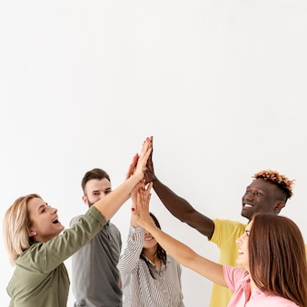 Copy-space young friends all high five at once