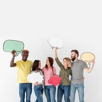 Copy-space young friends holding chat bubble