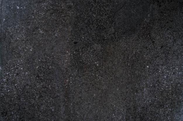 ダークブラックグレーの石。表。負のスペース、copyspaceトップビュー