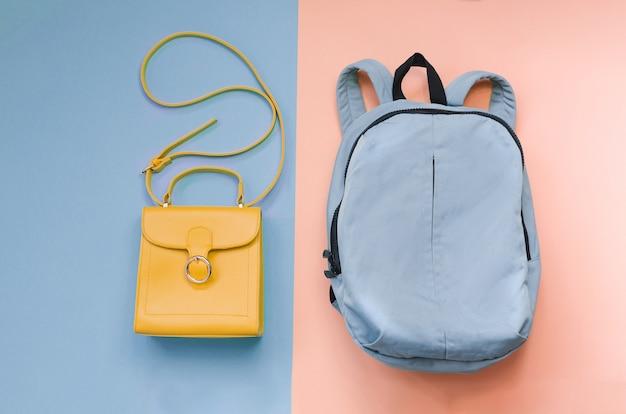 Соломенная шляпа лета и оранжевая сумка на красочном. концепция отдыха, copyspace