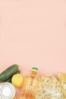 Рис, макароны, консервы, огурцы, лимоны. copyspace.