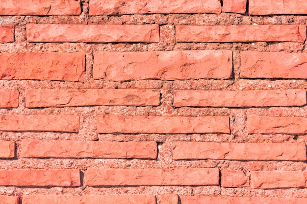 Coral living trendy color grunge brick texture.