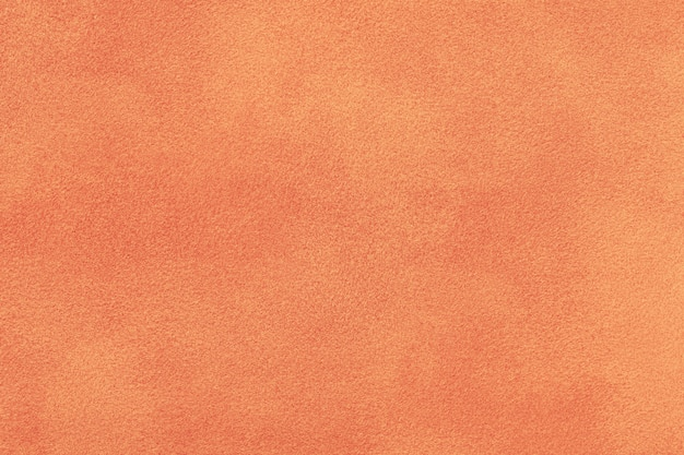 Coral matt suede fabric. velvet texture background