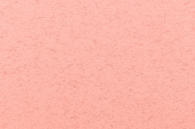 Coral pink pattern texture. paper with little hairs or scratches.