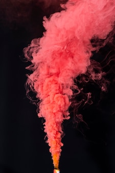 Coral red smoke effect on a black background