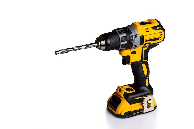 Cordless drill and a drill on a white background