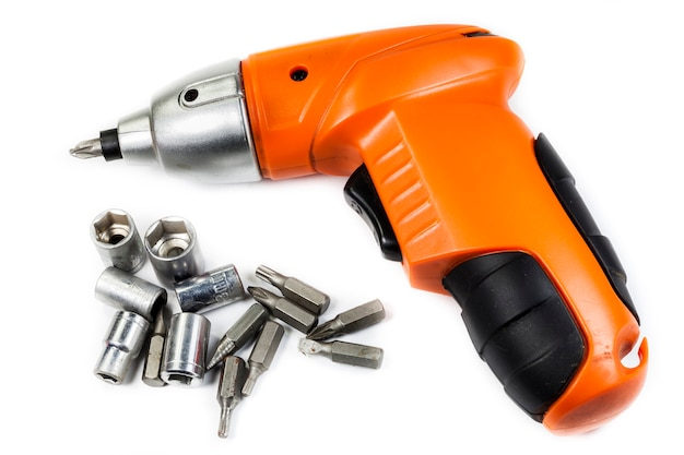 Cordless drill with different tips on white
